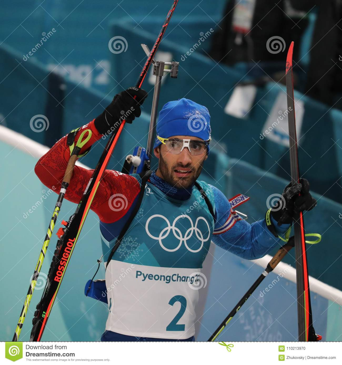 Olympic champion Martin Fourcade of France celebrates victory in biathlon men`s 15km mass start at the 2018 Winter Olympics