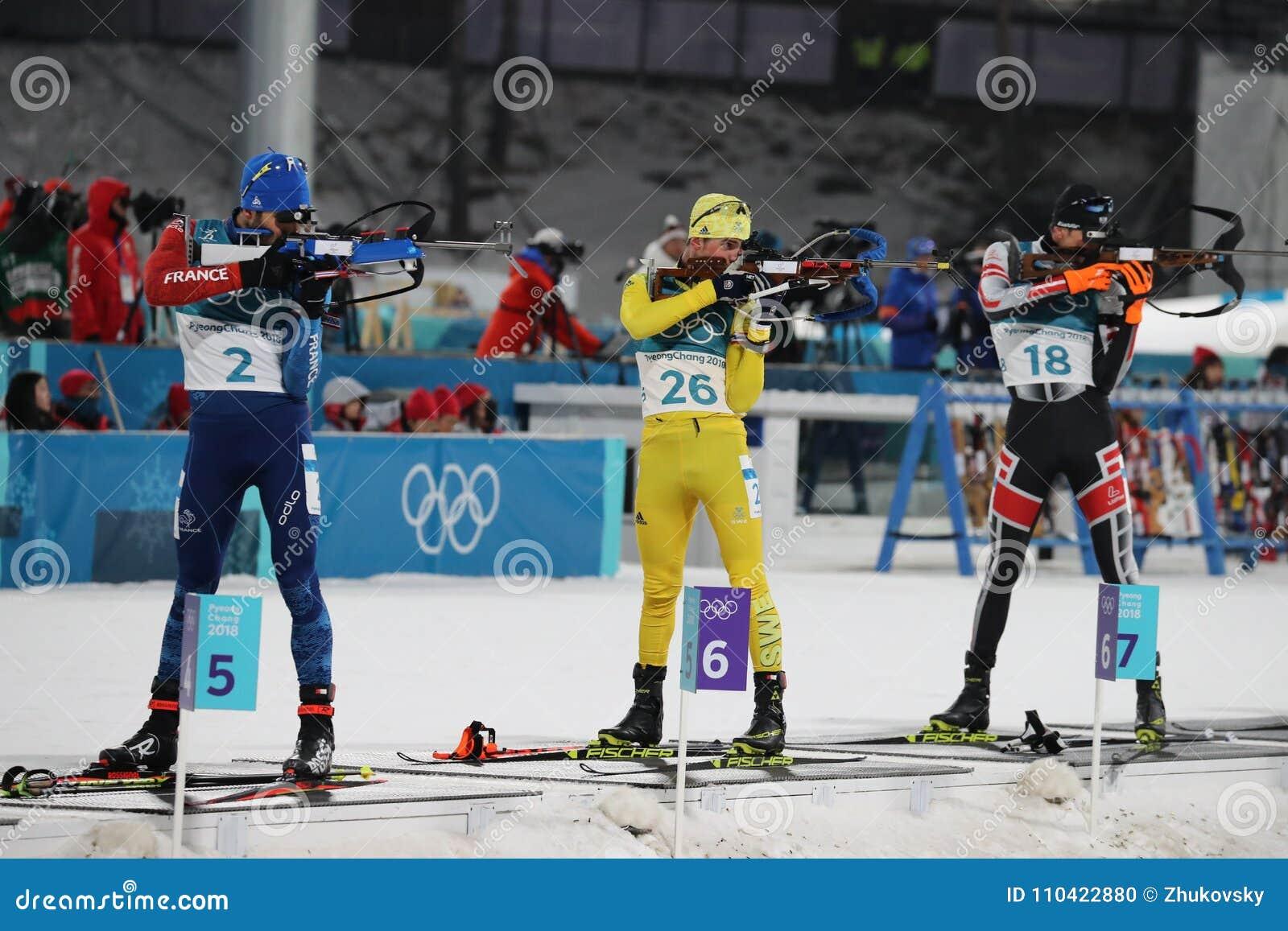 Olympischer Meister Martin Fourcade von Frankreich konkurriert im Biathlonmänner ` s 15km Massenanfang an den 2018 Winter Olympic