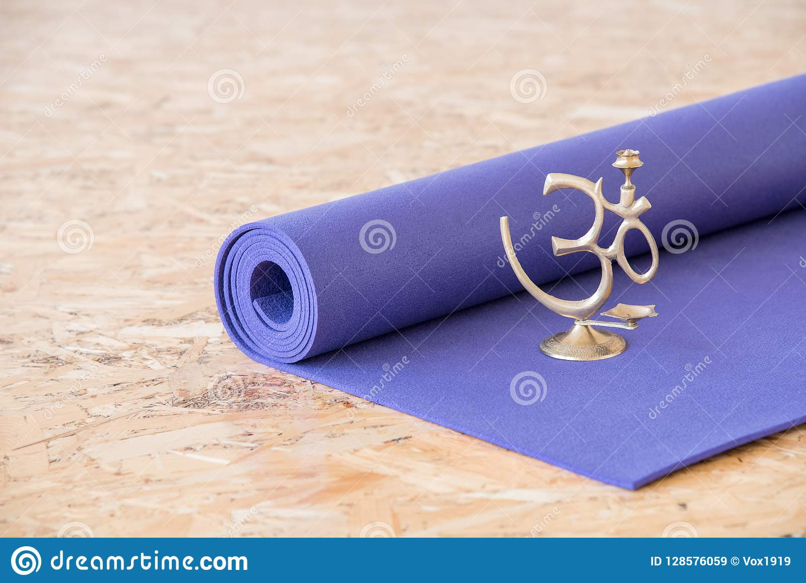 om meditation sign on a yoga mat in the training room stock image