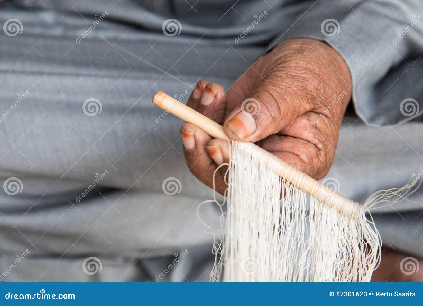 An Omani Man Weaving A Fishing Net  Editorial Stock Photo - Image of