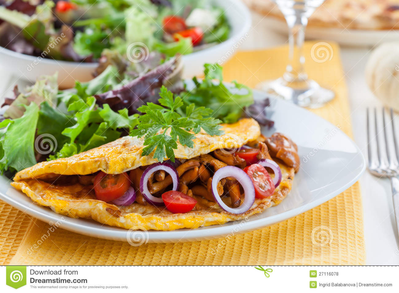 Omelet filled with chanterelle mushrooms