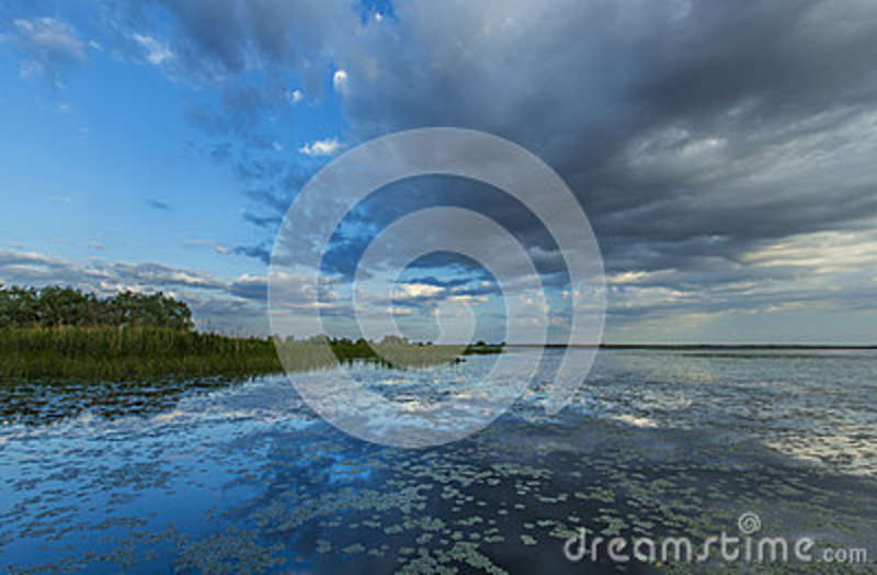 Ominous stormy sky reflection over natural lake