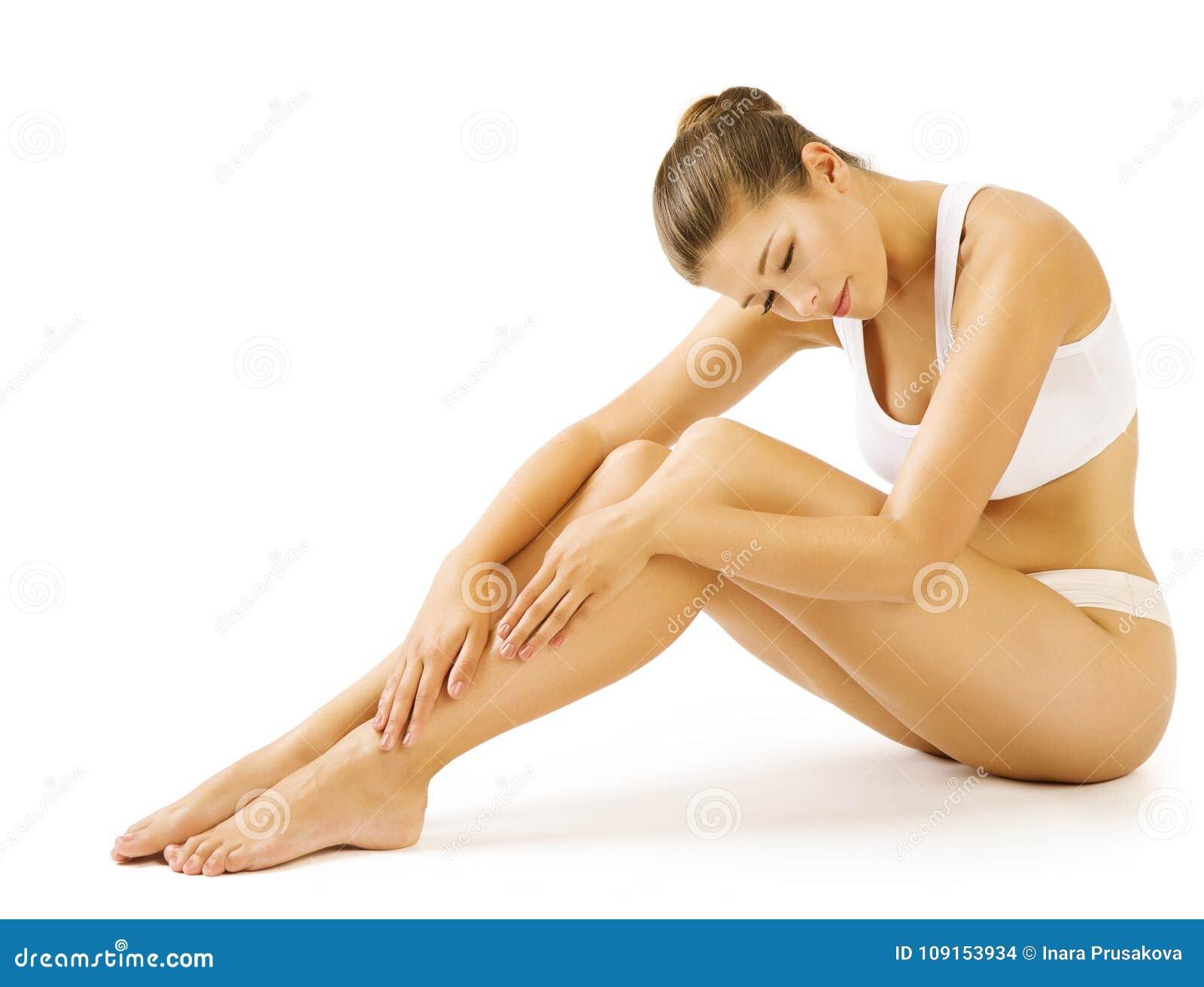 Omsorg för hud för skönhet för kvinnabenkropp, kvinnlig vit underkläder