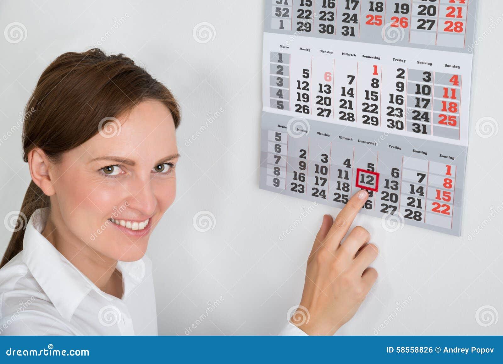 Onderneemster Placing Red Mark On Calendar Date