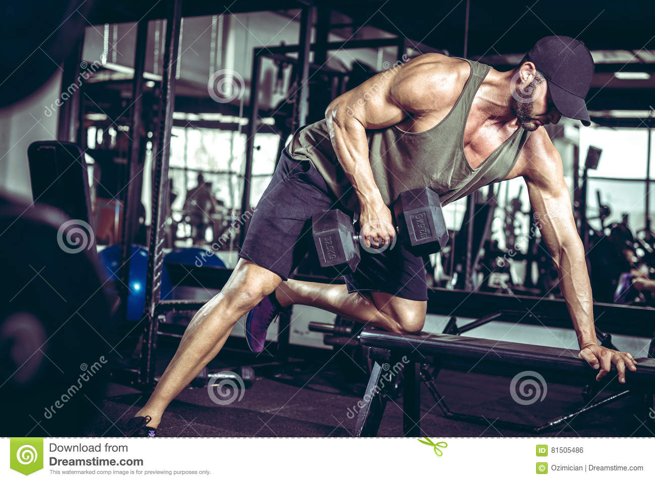 One-arm dumbbell rows in gym
