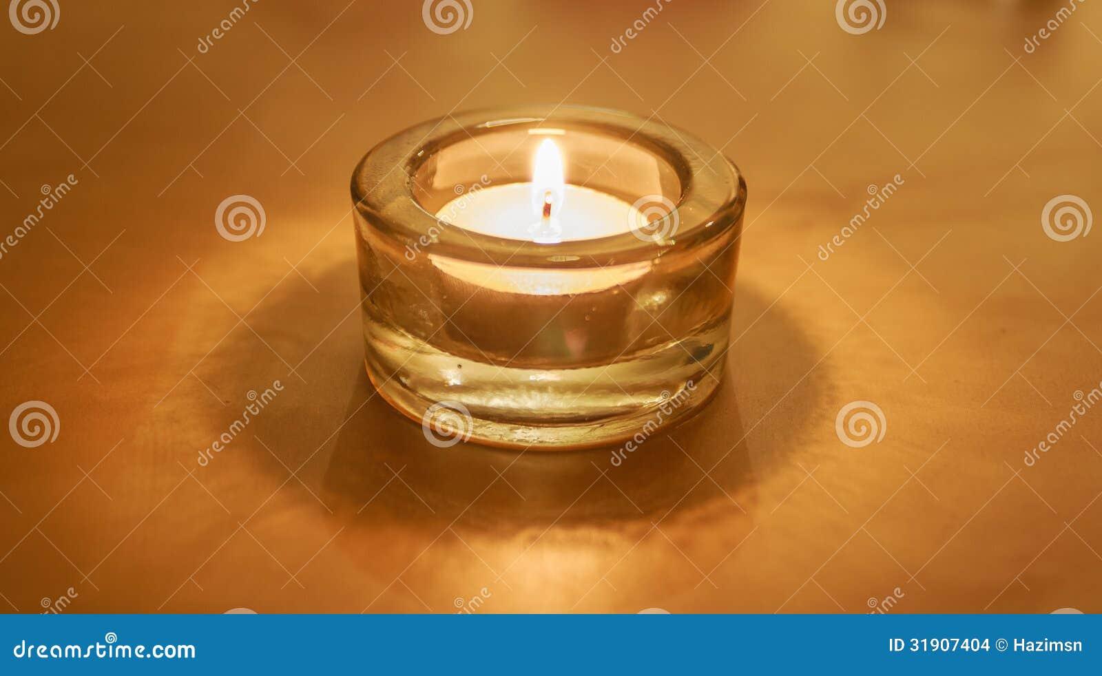 One Burning Tea Light Candle On Gold Stock Images Image