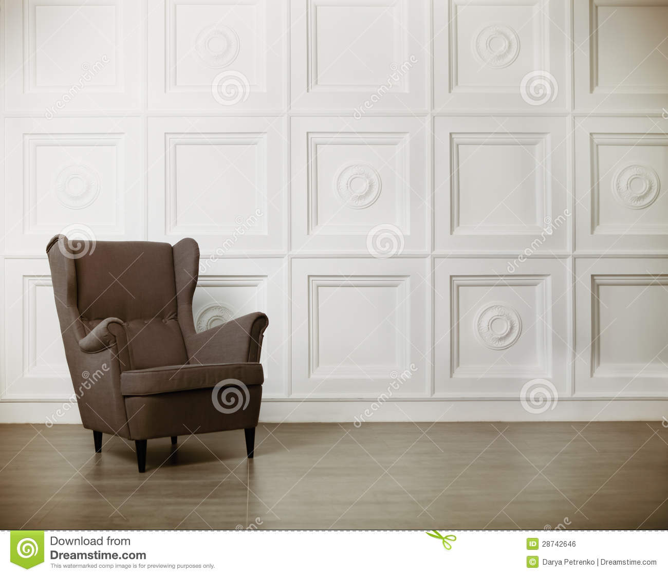 One Classic Armchair Against A White Wall And Floor Stock