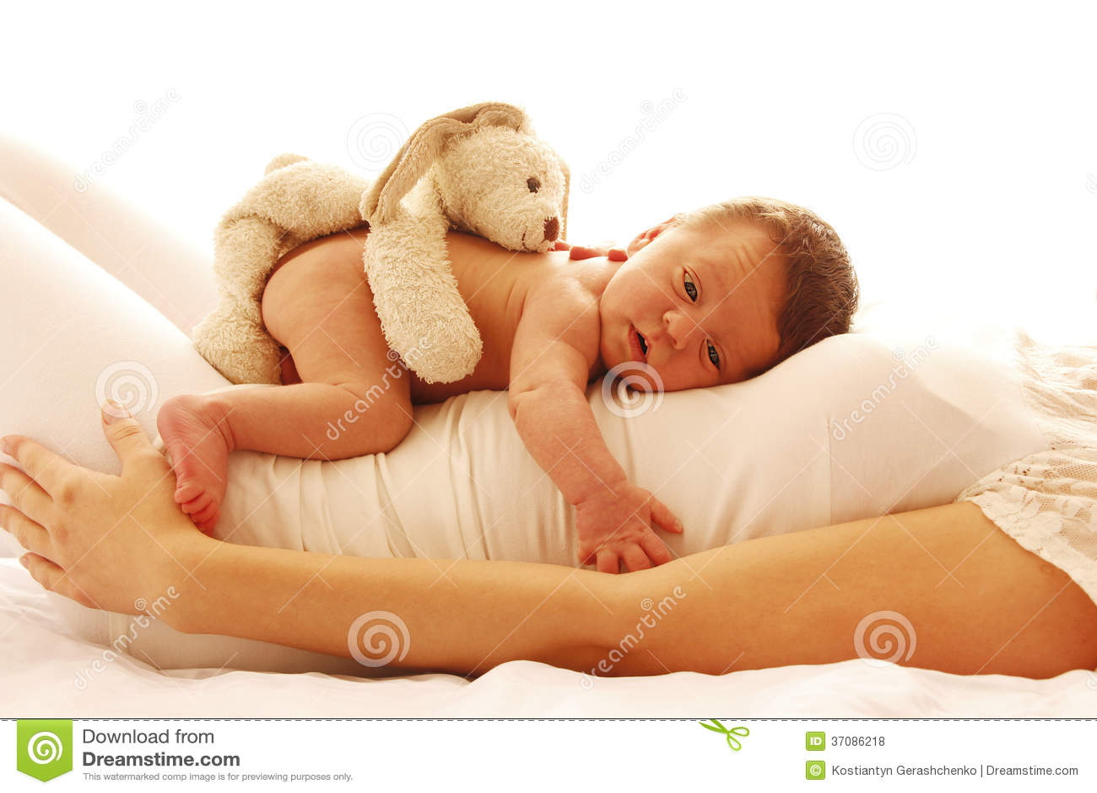 One cute little newborn baby lying on his mom stock photo - Como hacer fotos a bebes en casa ...