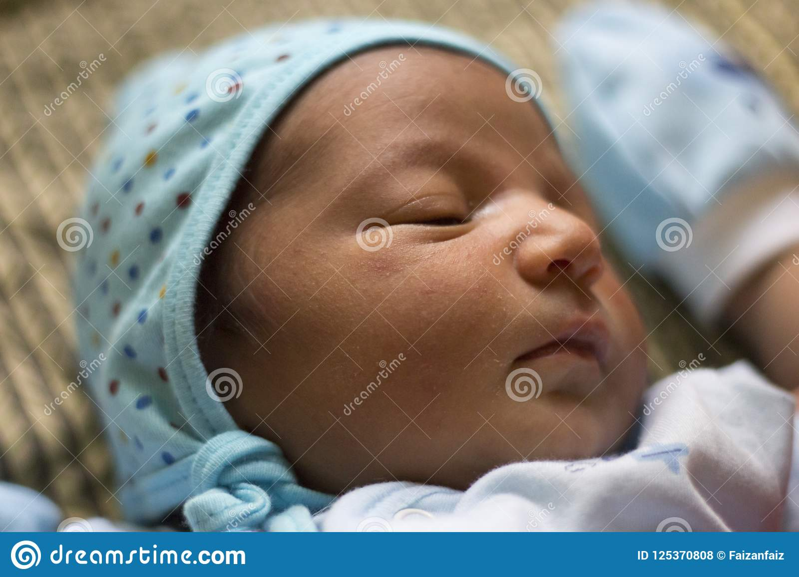 One day old indian asian infant newborn baby black and white picture