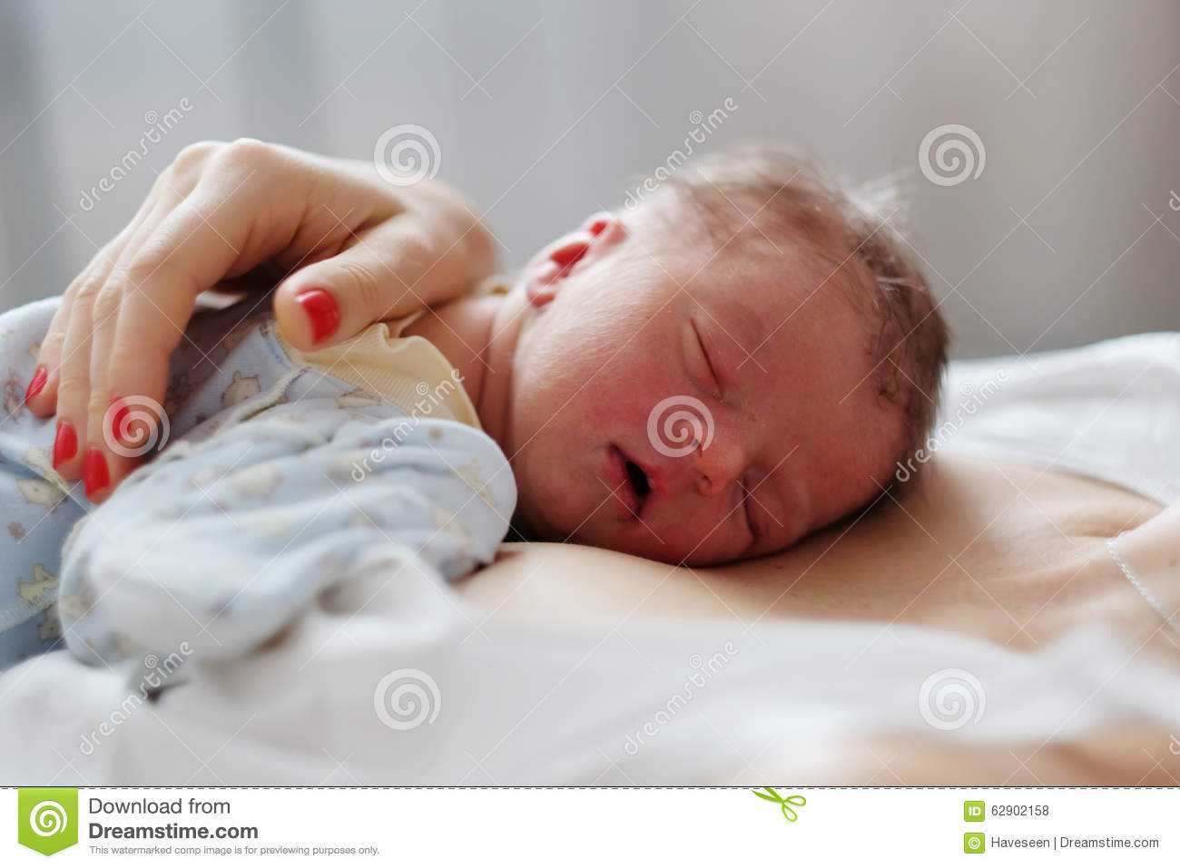 One day old newborn baby with mother