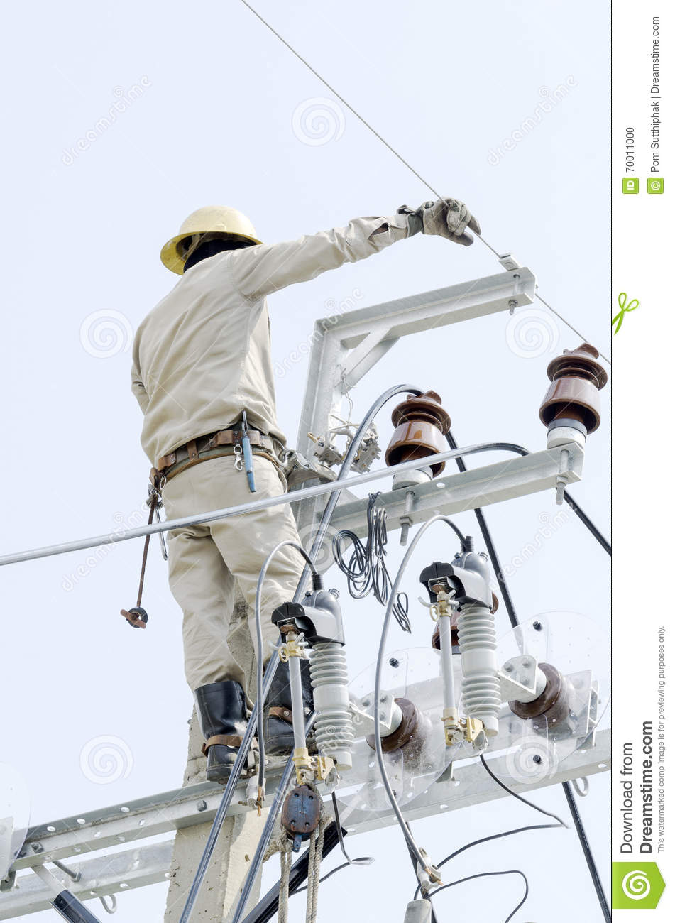 One Electrician Is Repairing Wire On Electric Power Pole
