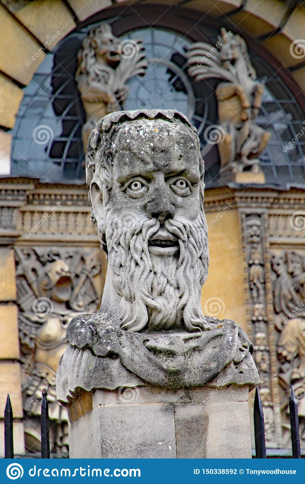 One of the Emperor`s heads outside the Sheldonian Theatre in Oxford