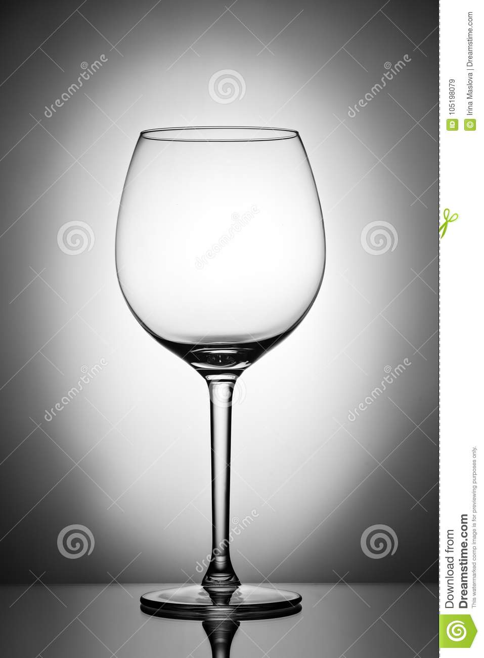 One empty wineglass for red wine on diffusion lit background