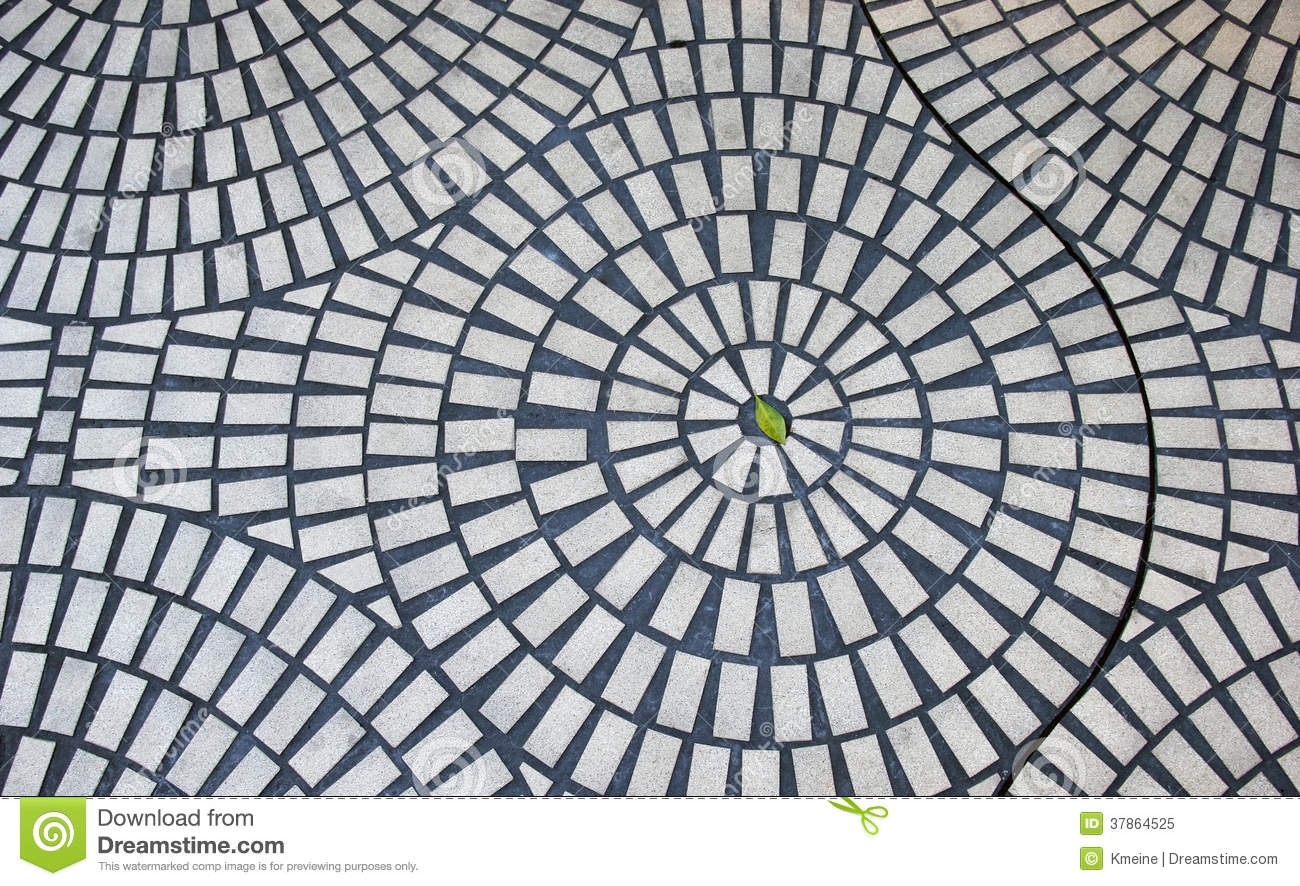 One Green Leaf In Circular Brick Pattern Stock Image