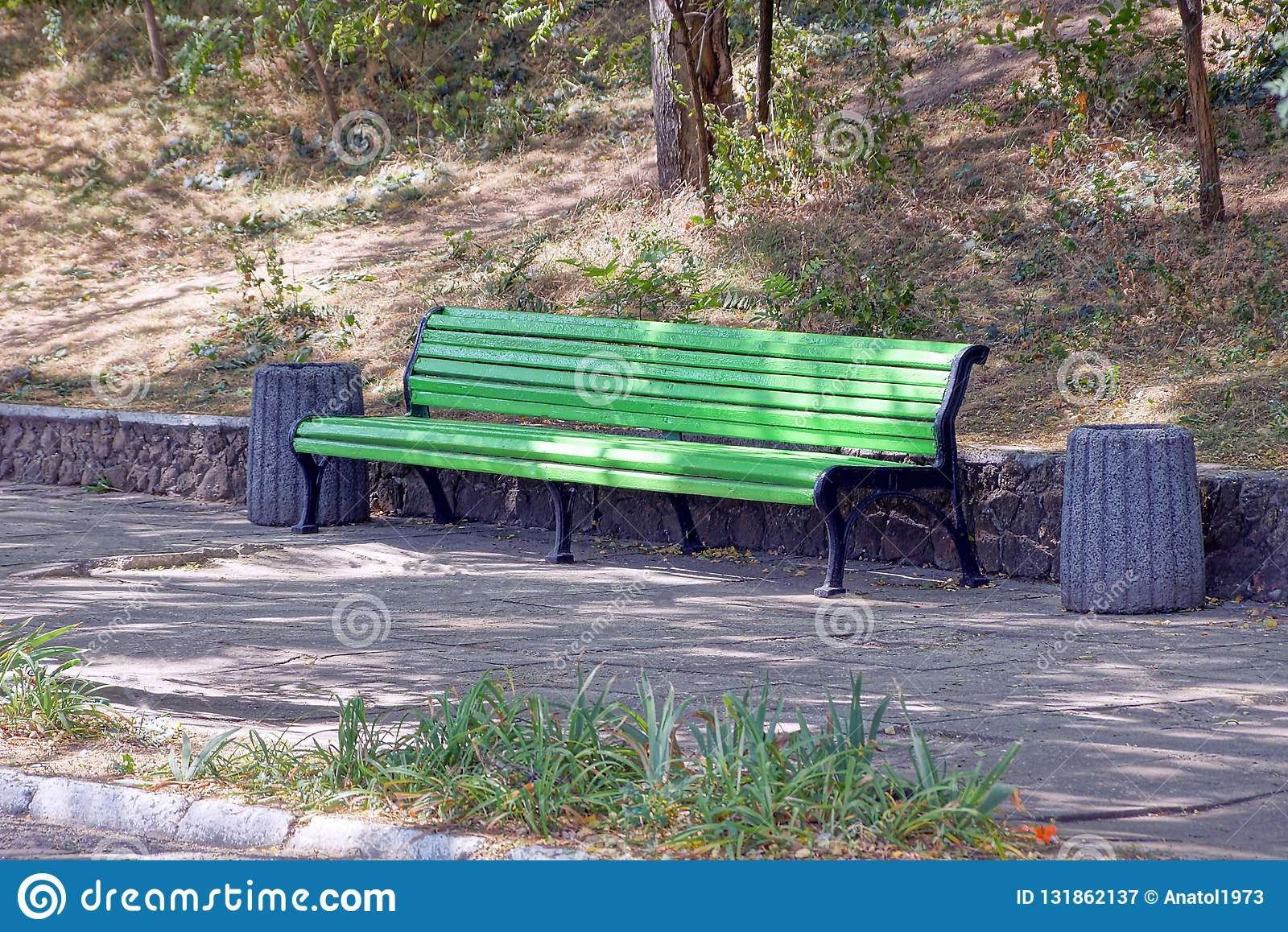 Remarkable Green Wooden Bench With Bins Stand On The Asphalt In The Gmtry Best Dining Table And Chair Ideas Images Gmtryco