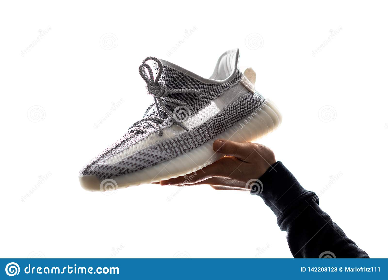 c23a50a1 One Hand Holds A Adidas Yeezy 350 V2 Static In Its Hand.. Released ...