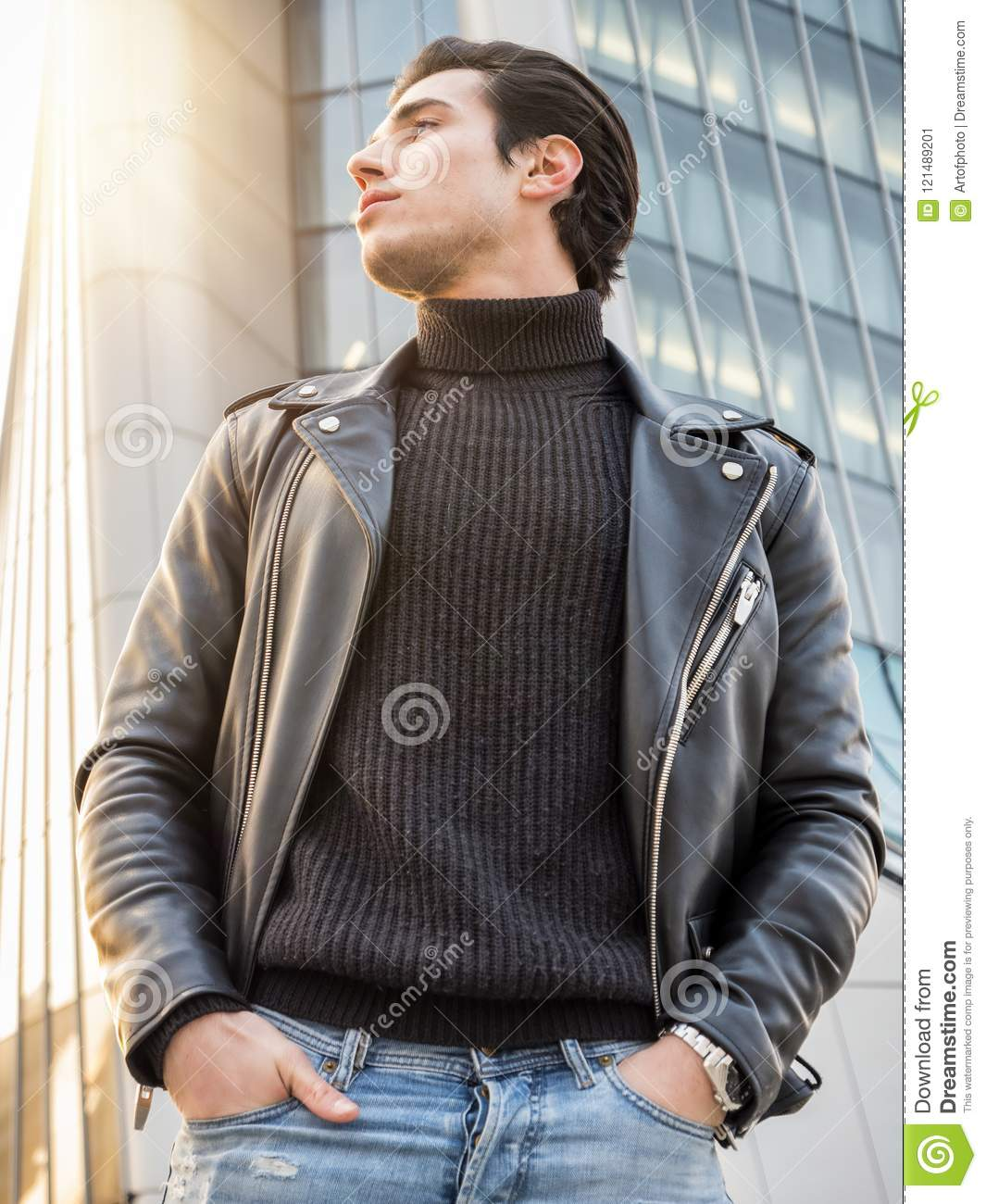 One handsome young man in modern city setting