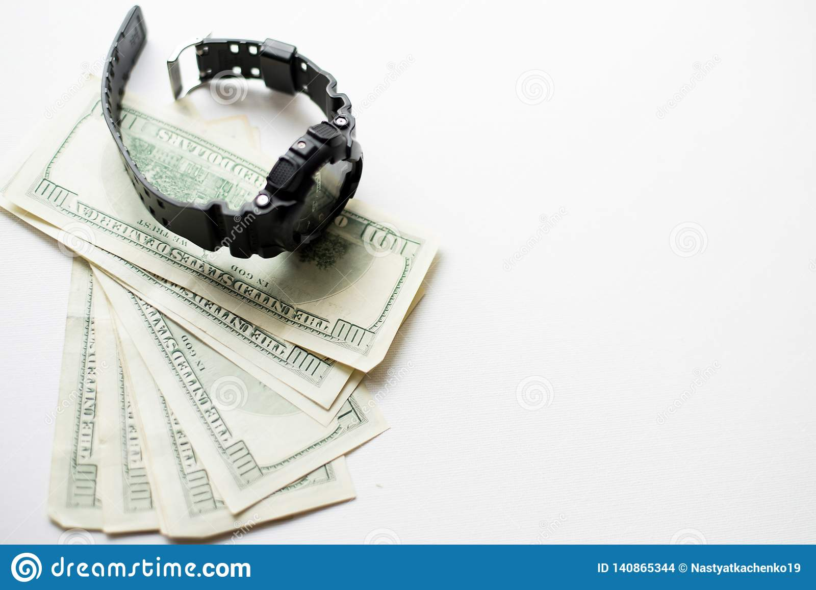 One hundred dollars with modern wristwatch isolated on white background. black watch with money
