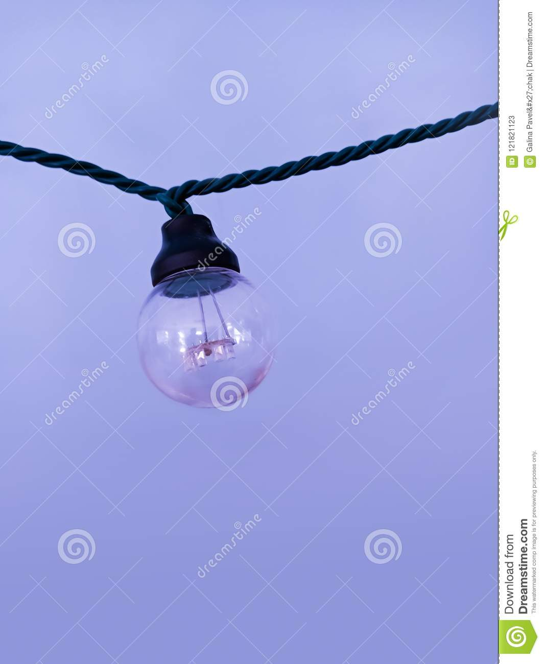One lamp hanging in a garland.
