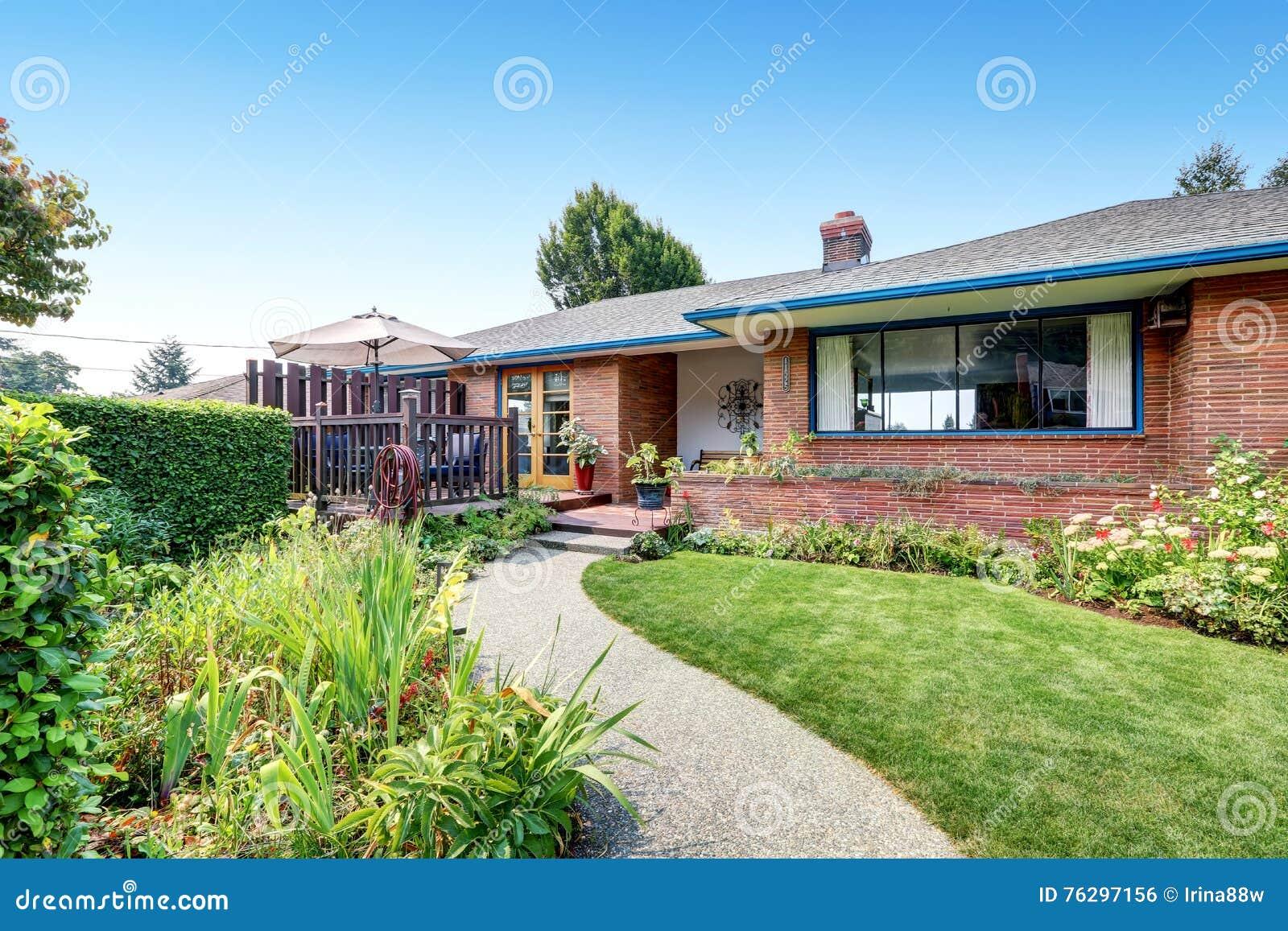 One Level Red Brick Rambler House Exterior Stock Photo