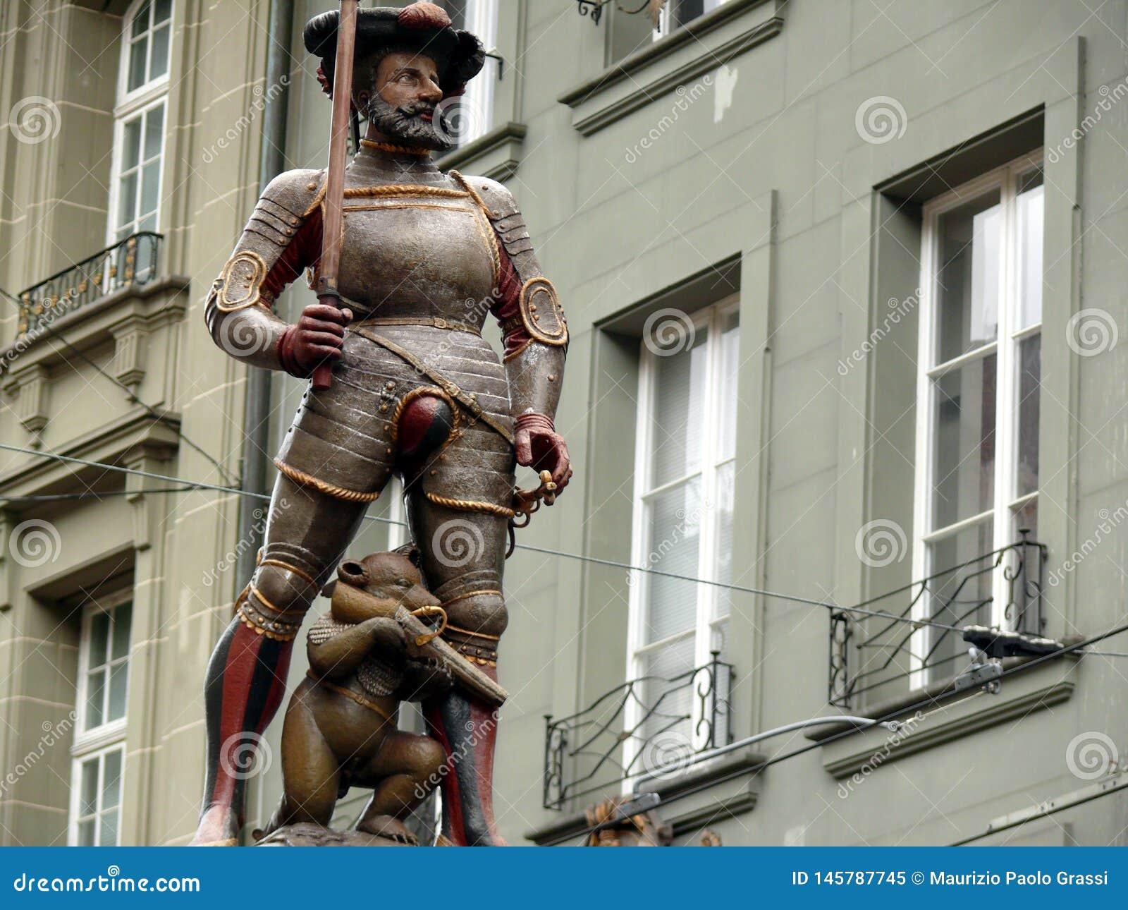 Bern, Switzerland. 08/02/2009. Bear monument with hunting rifle