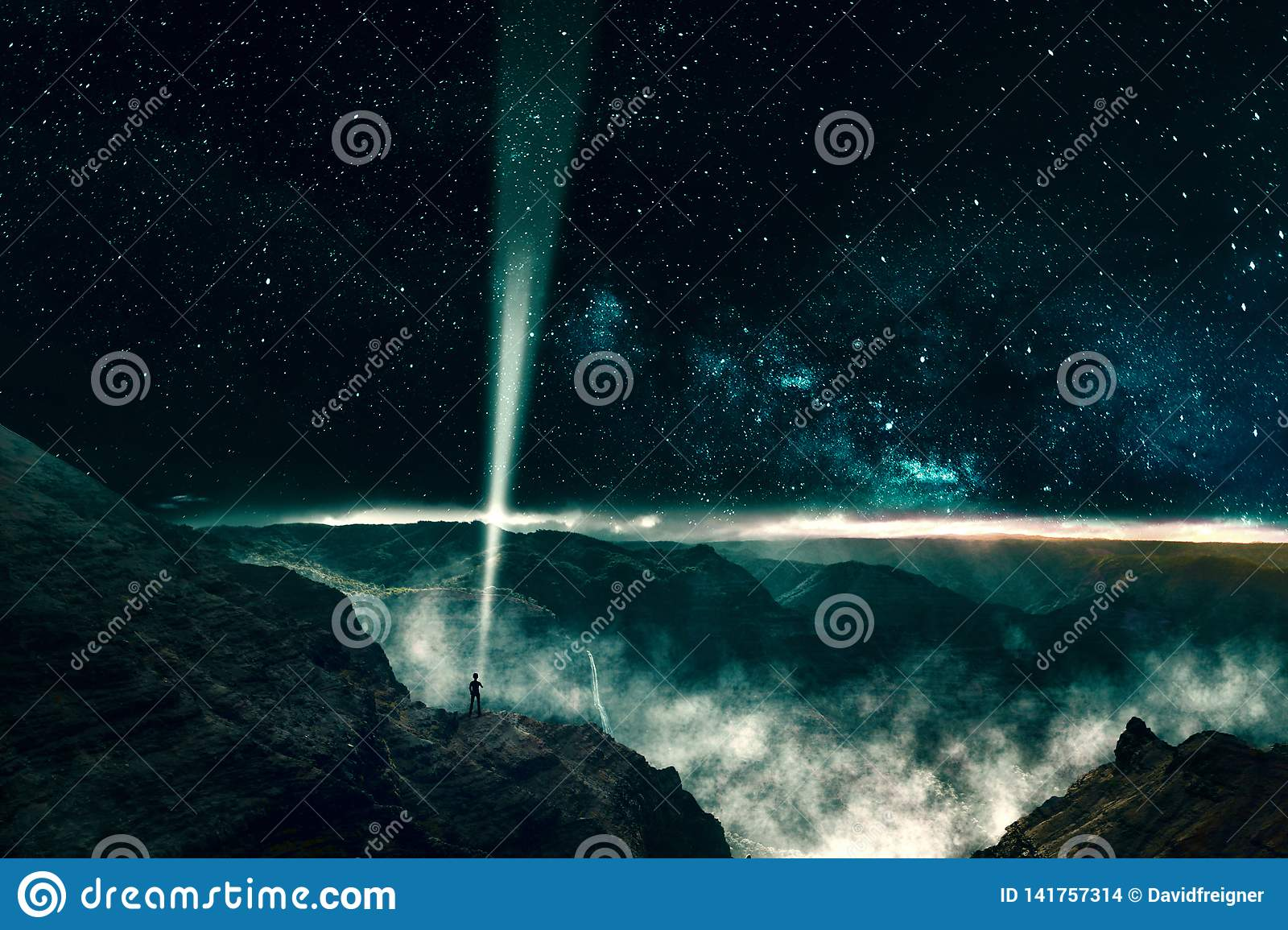One person sending a light beam signal into outer space. Concept for astronomy, science and technology