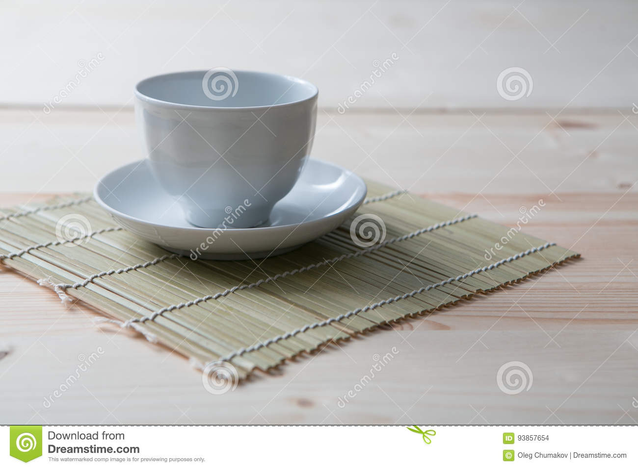 One Pure White Ceramic Cup And Saucer Stands On A Wooden Table Stock