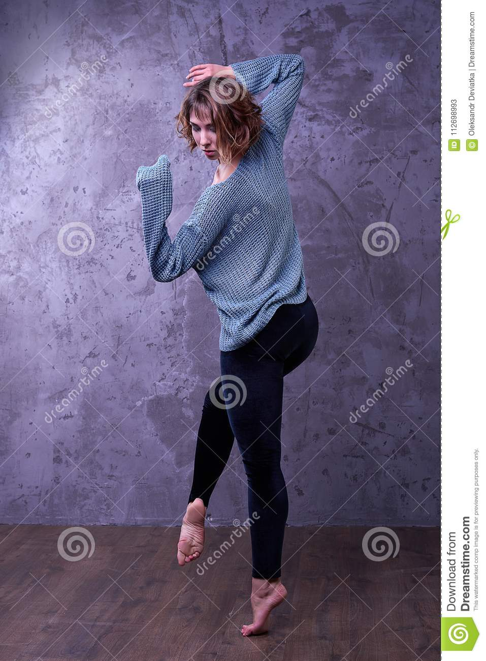 Beautiful girl dancer awesome dance posing on gray background
