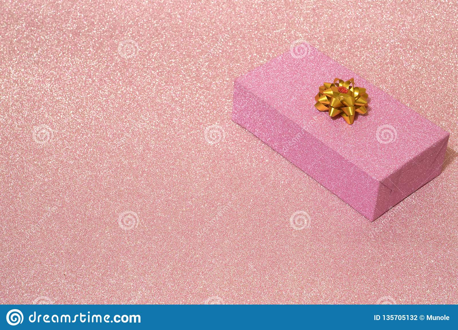 One Shiny Pink Box On A Pink Shiny Background Stock Photo - Image of