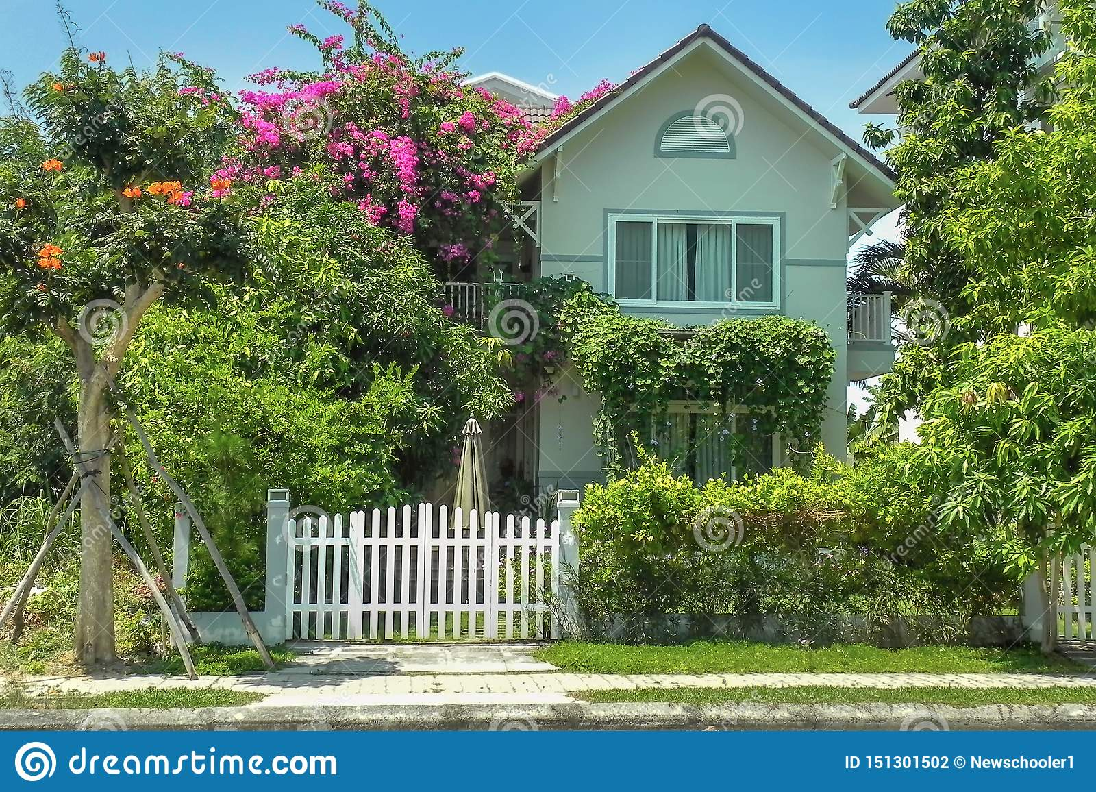 One Small Cozy Two Storey House With P Trees And Landscape Design