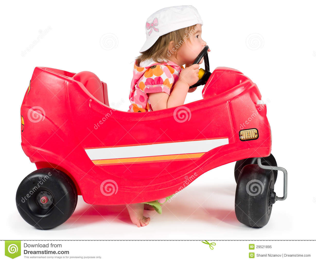Small Toy Cars : One small little girl playing with toy car royalty free