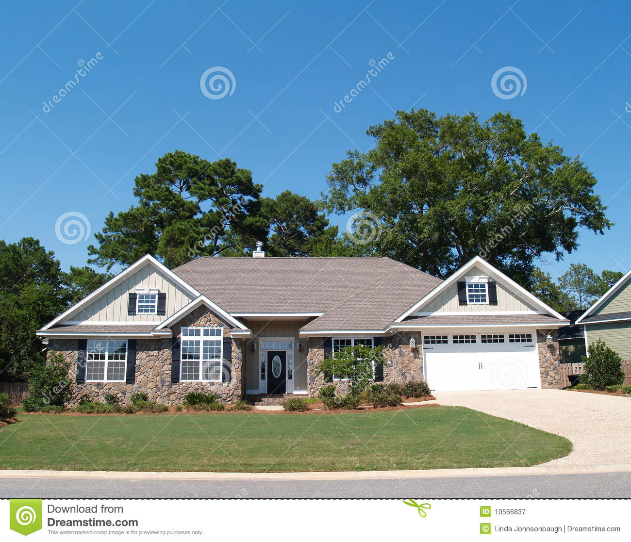 One story stone residential home royalty free stock for Residential house pictures