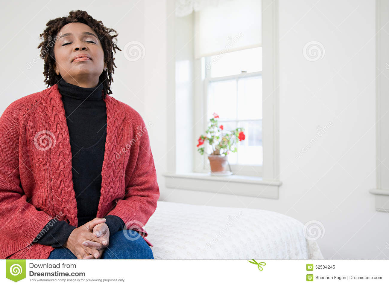 One woman with her eyes closed