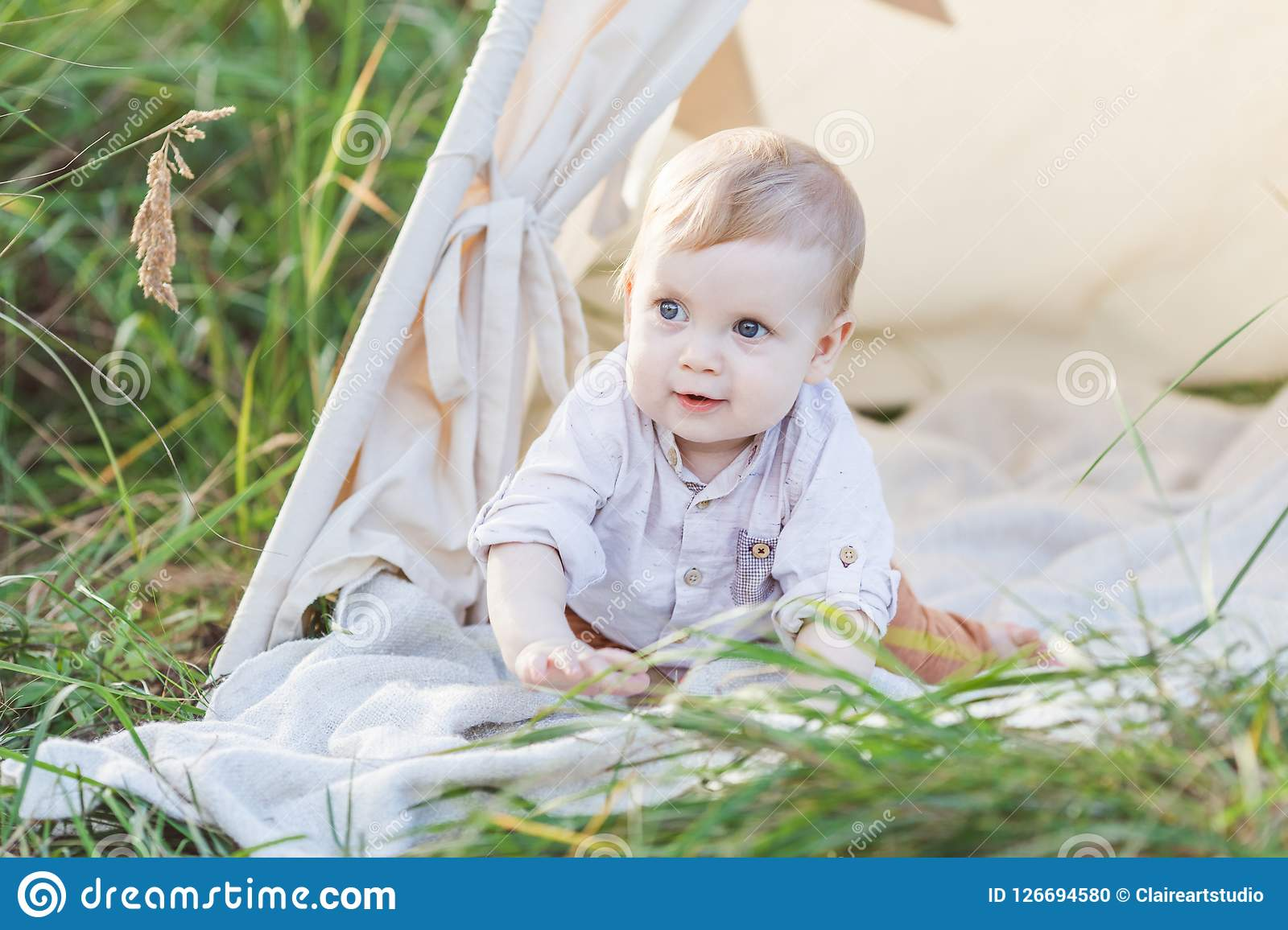 online store 2db86 28af8 One Year Cute Boy In A Teepee Outdoors. Stock Photo - Image ...