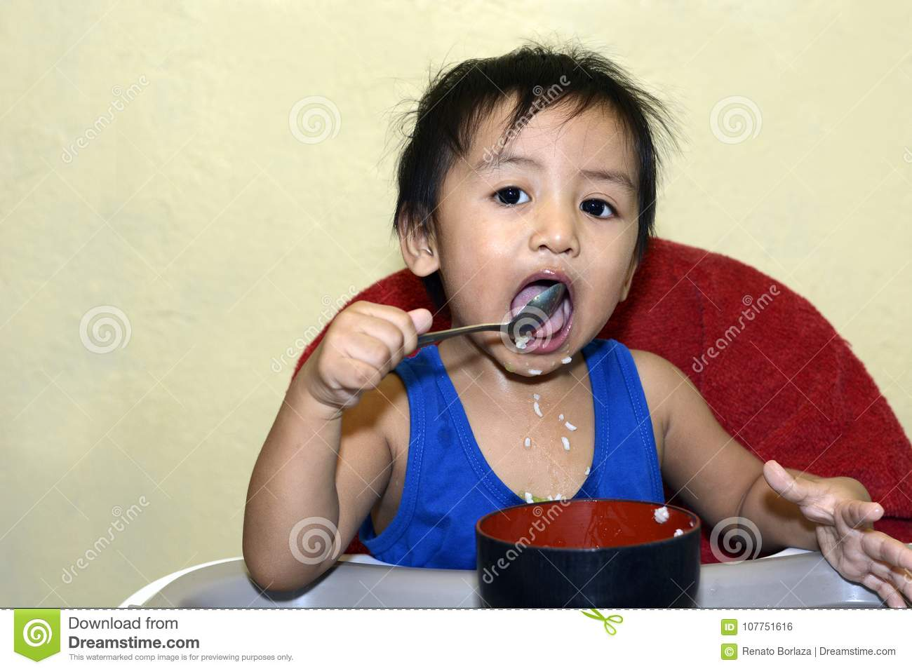 Download One 1 Year Old Asian Baby Boy Learning To Eat By Himself By Spoon  sc 1 st  Dreamstime.com & One 1 Year Old Asian Baby Boy Learning To Eat By Himself By Spoon ...
