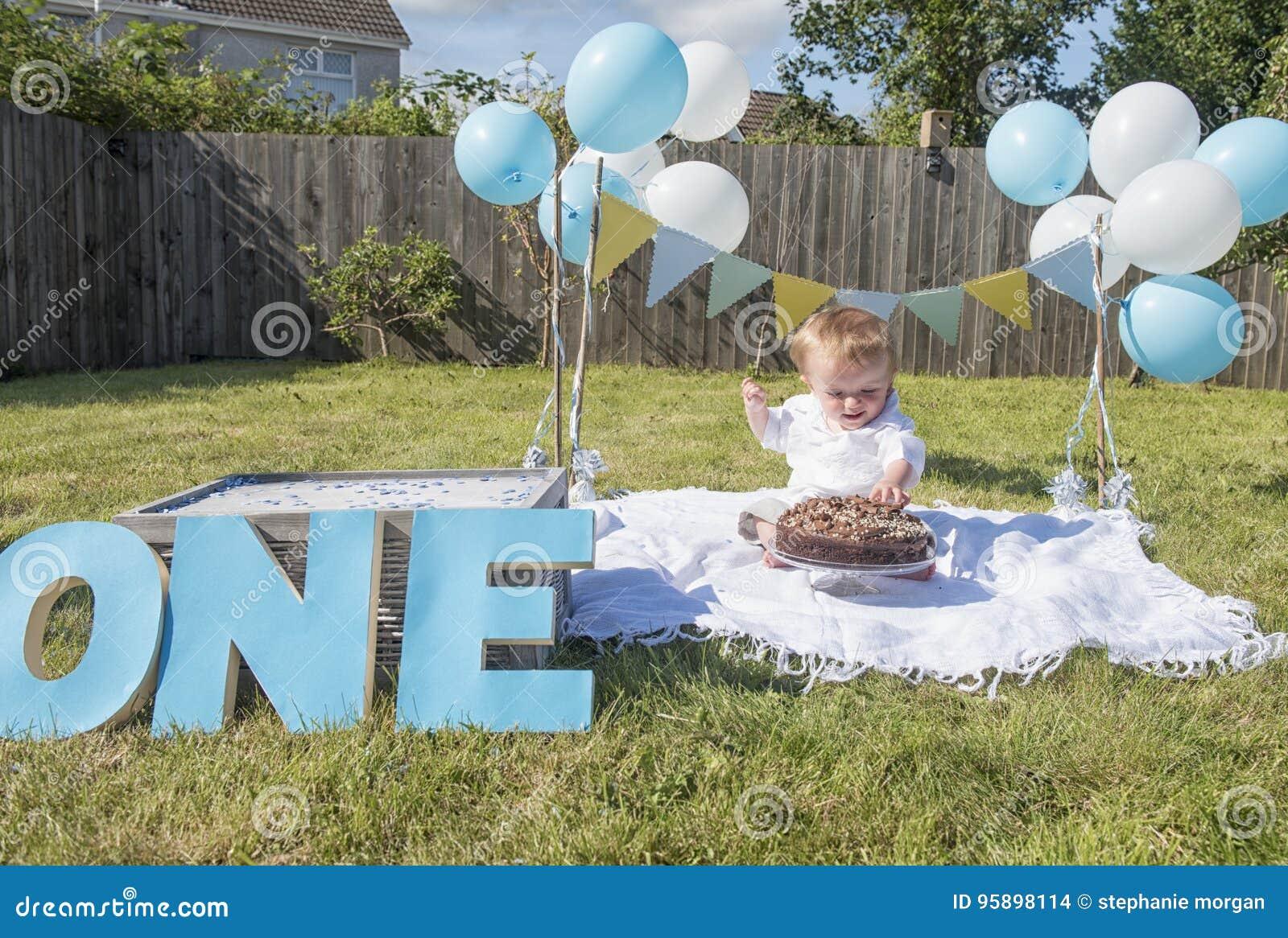 One Year Old Baby Boy Chocolate Cake Smash Stock Photo