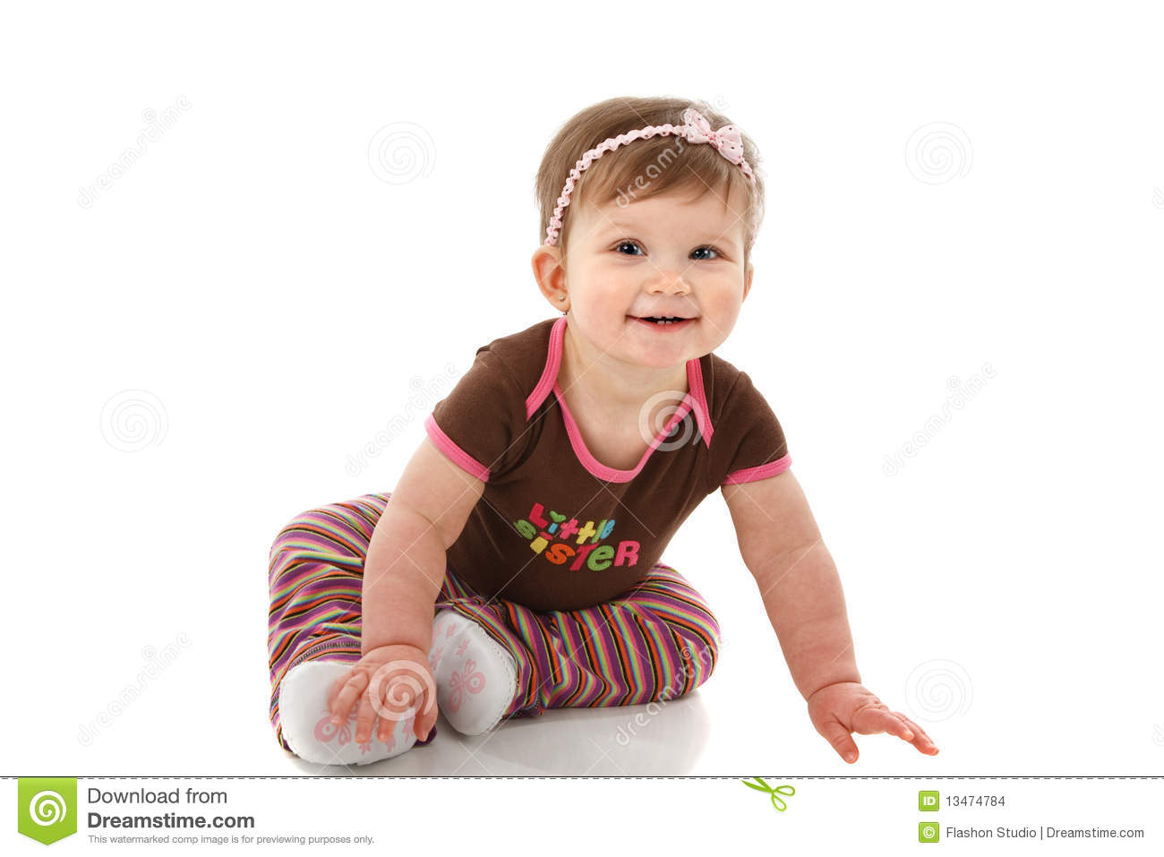 One Year Old Baby Girl Sitting On Floor Smiling Stock