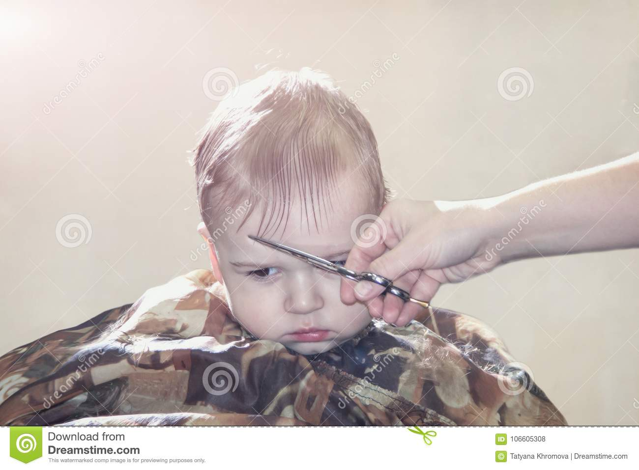 One Year Old Boy For The First Time Makes The Haircut In A Barber