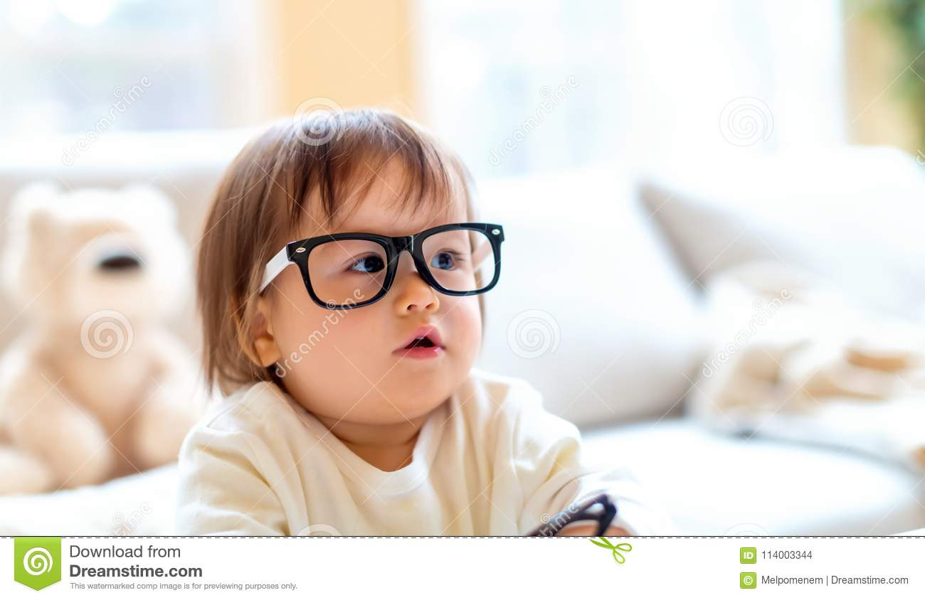 40fd1ca0085b One Year Old Toddler Boy With Eyeglasses Stock Photo - Image of ...