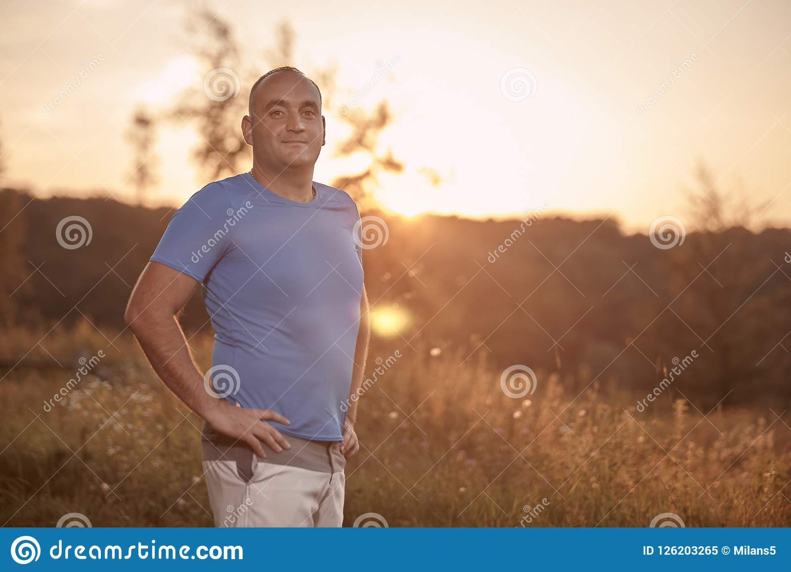 One young overweight man, 30-35 years, proud, posing standing,