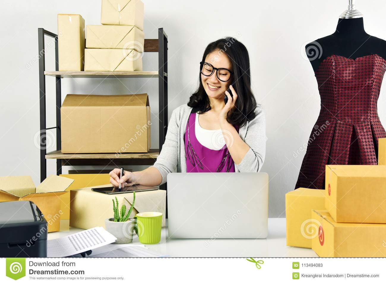 Online business, Young asian woman work at home for e-business commerce, Small business owner checking and packing online order.