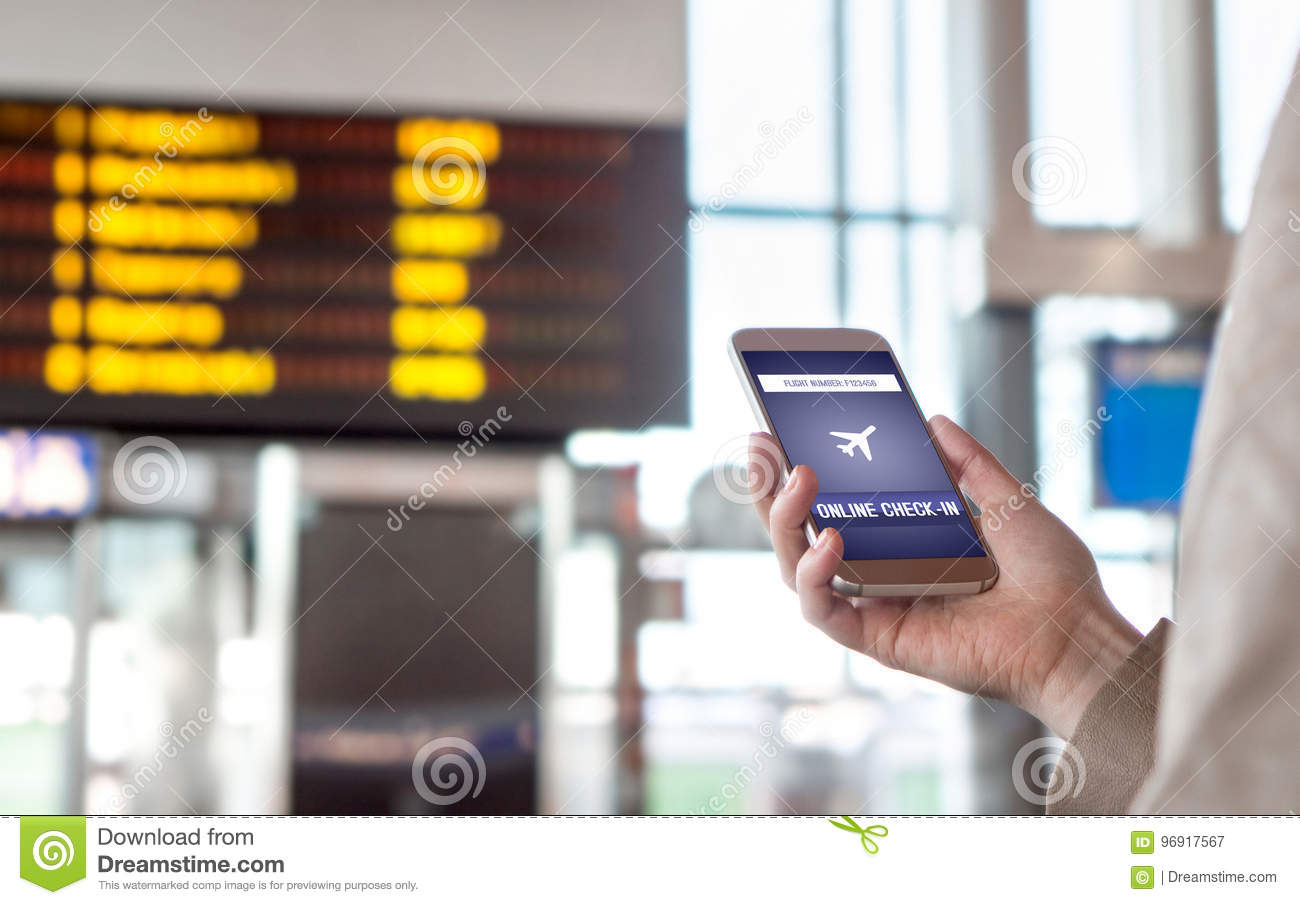 Online Check In With Mobile Phone In Airport  Stock Image - Image of