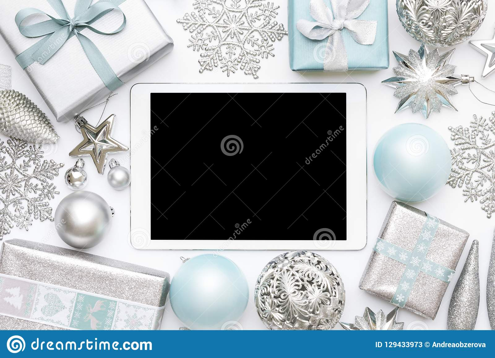Online Christmas Shopping. Boxing Day Sale Background. Wrapped christmas presents, ornaments and blank screen digital tablet.