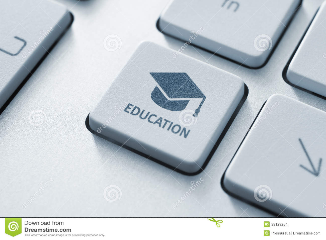 Button with graduation cap icon on a modern computer keyboard. Online ...