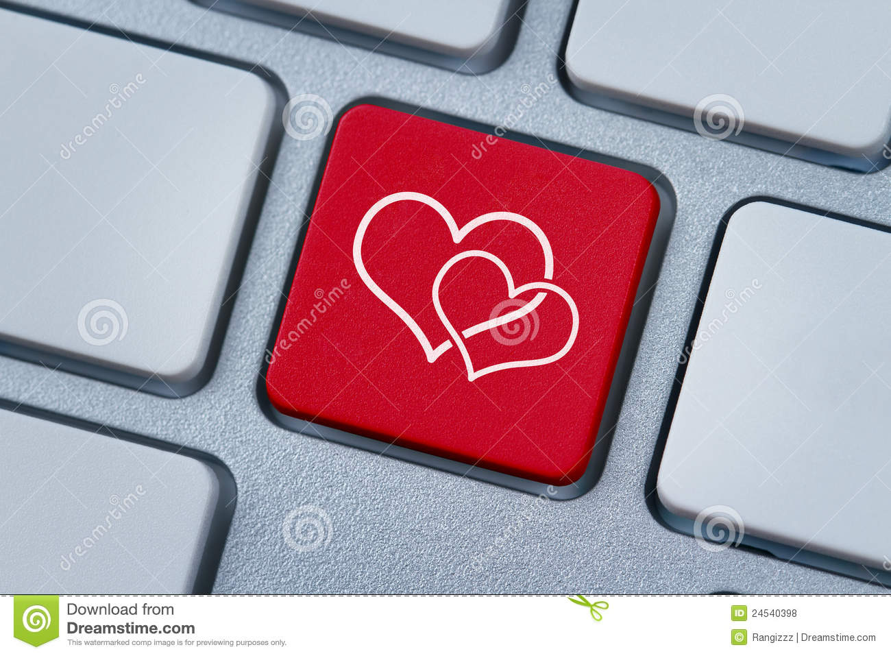 Online Love Two Hearts Symbol At The Computer Key Stock Photo