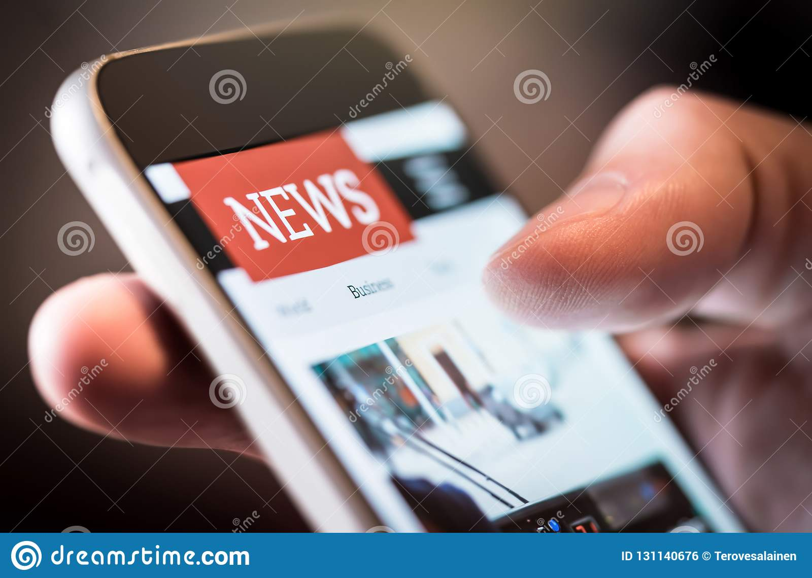 Online news in mobile phone. Close up of smartphone screen.