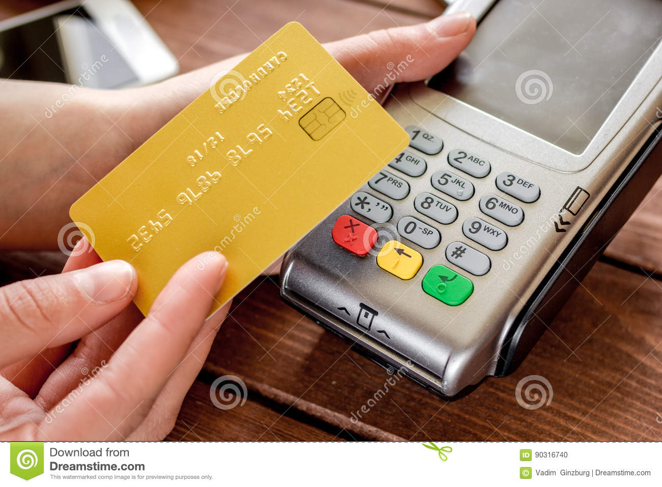 Online Payment Concept With Credit Card And Terminal On Wooden ...