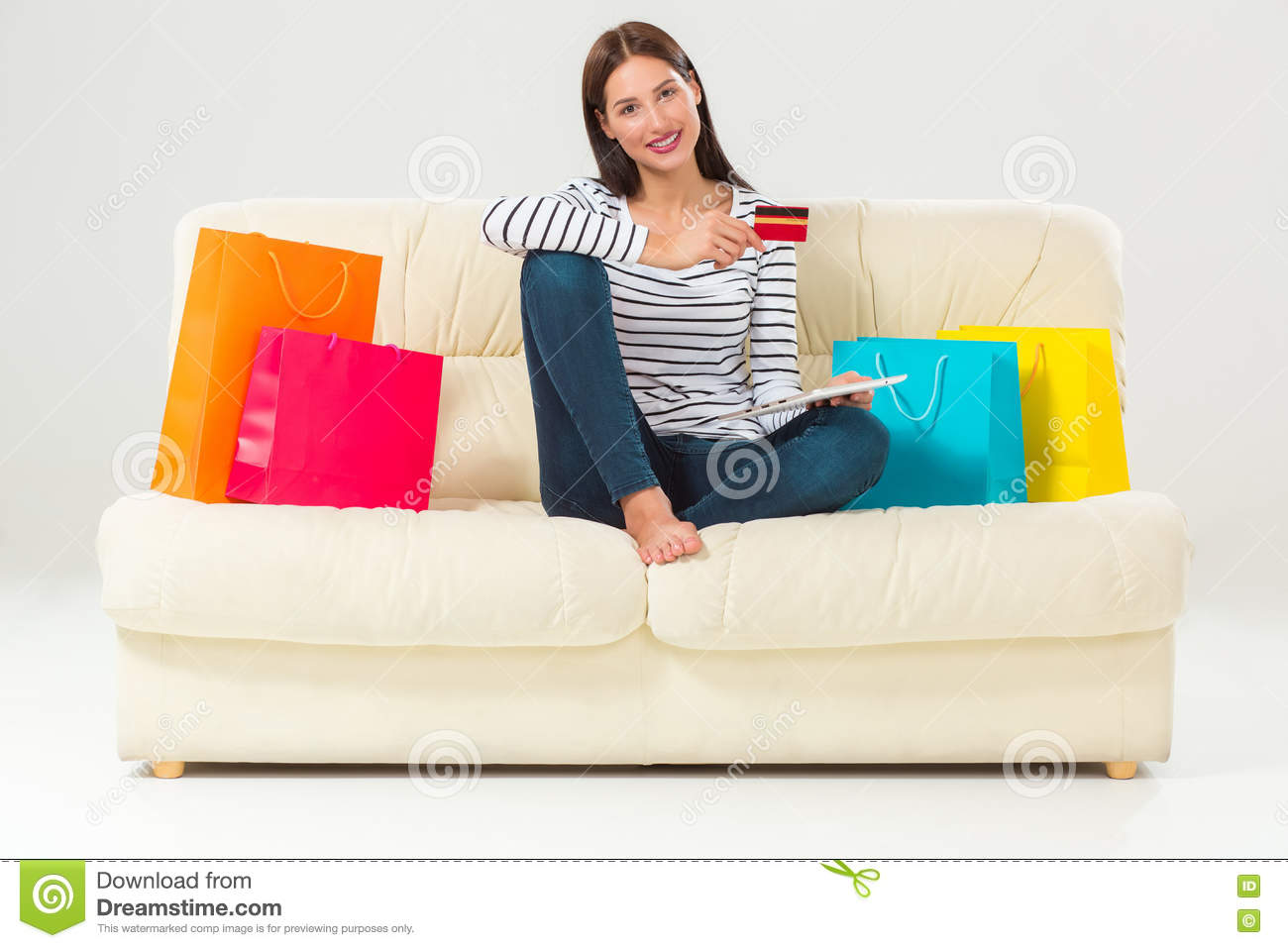 smiling woman shopping online home credit card stock photography 28711430. Black Bedroom Furniture Sets. Home Design Ideas