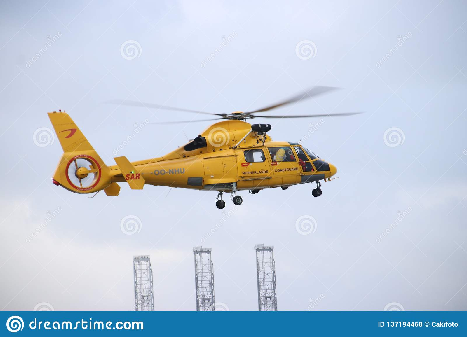 OO-NHU helicopter from the coastguard in the Netherlands is leaving platform for action in the Europoort harbor in the port of Rot