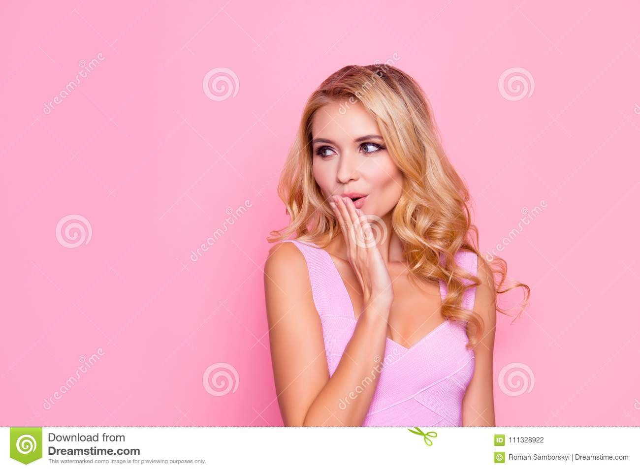 Oops! Close up portrait of sexy, beautiful, impressed, amazed blonde girl holding her hand near mouth, looking to the side on pink